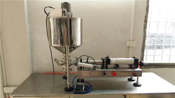 अच्छी गुणवत्ता डबल सिर मिर्च सॉस भरने की मशीन